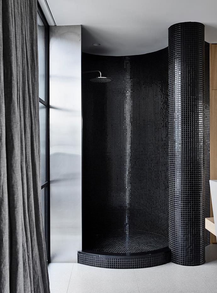 In the bathroom, 'Platinum' floor tiles from Fibonacci Stone. Brodware showerhead.