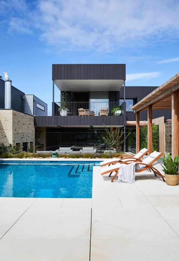 "**Exterior/pool** ""People driving past the front often stop and stare,"" says Jane of her beautiful home's exterior, featuring [Petersen Tegl](https://en.petersen-tegl.dk/
