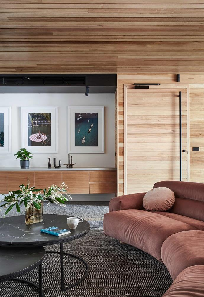"**Family room** Built-in credenza units work harmoniously with the loose furniture in this relaxed family zone. Valley curved sofa, [Jardan](https://www.jardan.com.au/|target=""_blank""