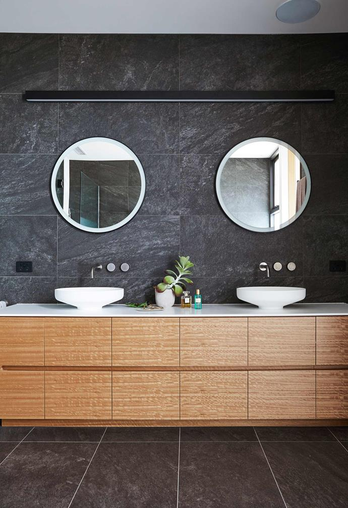 "**Ensuite** ""Two tones of dark grey tiles create a moody and personal space, offset by timber veneers and soft wall lighting,"" says Frank of Paul and Jane's exquisite bathroom. Atlas Brave wall and floor tiles in Coke and Grey, [Volaré Tile Concepts](https://volare.com.au/
