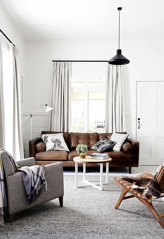 """The curtains in the living room of this [Daylesford cottage](https://www.homestolove.com.au/weatherboard-cottage-daylesford-17070