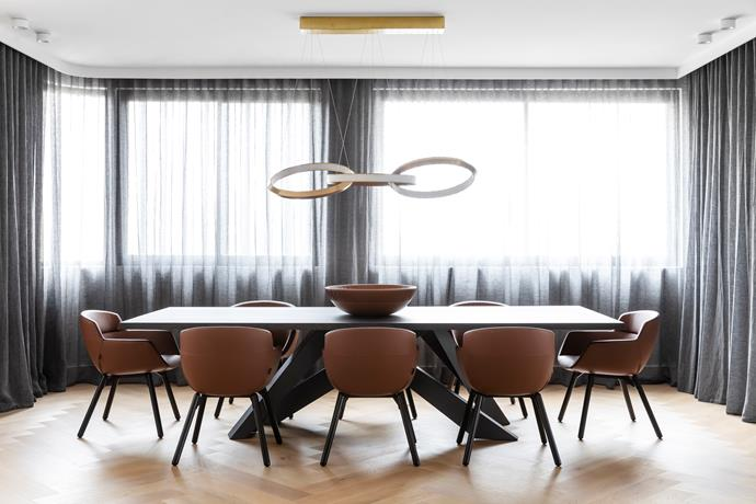 Artifort 'Mood Relax' dining chairs from Ke-Zu surround the Bonaldo 'Big Table' from Fanuli. Christopher Boots 'Oracle Triplet' pendant light from Est Lighting hangs above. Sheer curtains by Simple Studio. Poltrona Frau leather bowl from Cult.