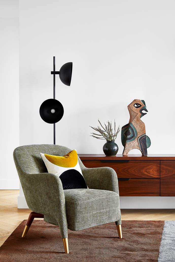 Molteni&C armchair by Gio Ponti from Hub sits in the corner of the living room guarded by a quirky vintage ceramic bird from Rudi Rocket. 'Studio' floor lamp from Fred International. 'Eclipse' cushion by India Mahdavi from Studio ALM. Green vase from Planet.