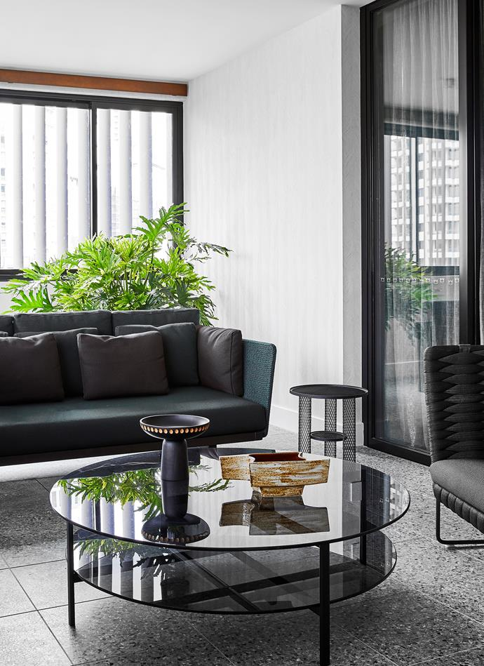 Ruta' coffee table from Ke-Zu and Paola Lenti sofa and armchairs from De De Ce make the perfect combination in the winter garden. Moroso 'Net' side table and Zanat 'Nera' bowl, both from Hub. Vintage ceramic from Rudi Rocket. Terrazzo floor from Surface Gallery.