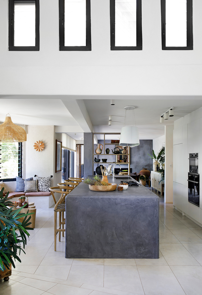 """Originally a U-shape, the kitchen was transformed into an open galley layout. Items ticked off the wishlist include a Zip HydroTap, an Italian pendant light bought overseas and Franke appliances. """"We never use more than two burners at a time so we got a small cooktop and it's perfect,"""" says Chris."""