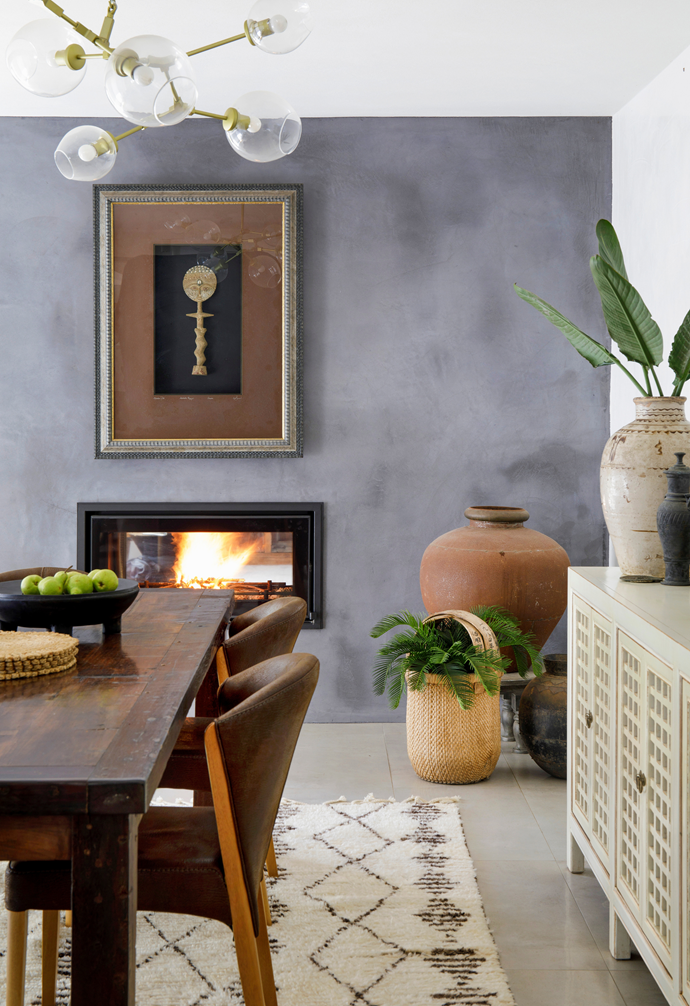 A double-sided Regency 'Mansfield' wood fireplace from BBQ & Fireplace Centre in Noosaville makes dining on chilly nights a delight.