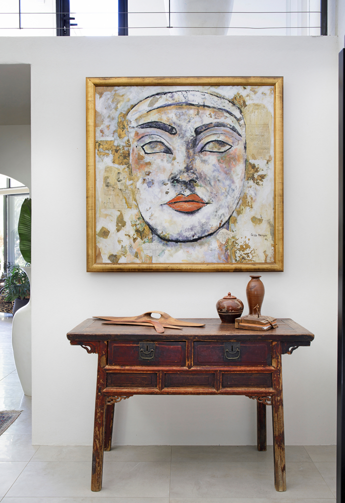 Visitors are greeted by an untitled artwork by Greg Mallyon above a vintage Chinese console in the entrance.