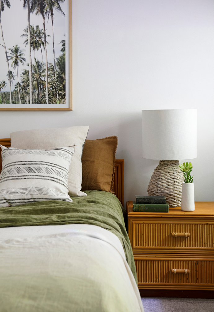 In the guest bedroom, a Feather + Oak throw complements a 'Holiday in the Palms' print from Middle Of Nowhere.