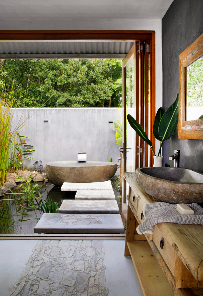 As far as Chris was concerned, the old bathroom had always felt small when compared to the home's scale. No more! The solution was to knock out a wall and extend it outwards for a secluded, resort-style outdoor bath.