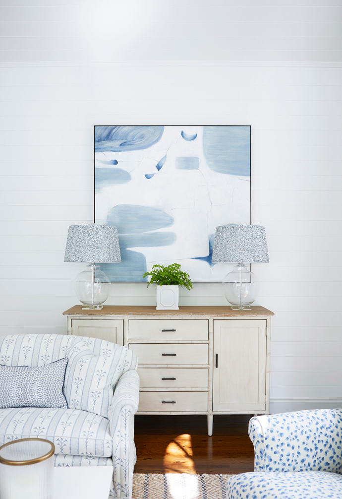 The symmetrical display on the 'palm beach' buffet, from Iluka Road Collection, enhances the serene colour scheme and takes advantage of the only available wall for artwork. Here, designer Melinda paired textural 'Lynx Pleated' lampshades from US company Ballard Designs with One World's glass lamp bases to complement the light palette.
