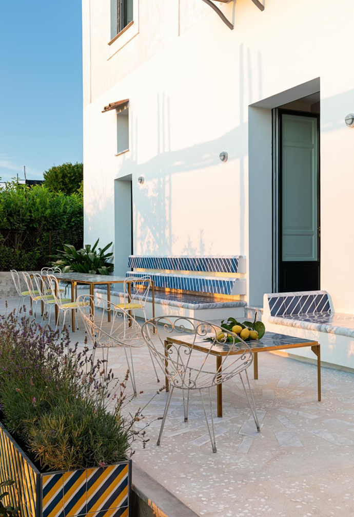 """Massimo and his guests can take in the postcard-perfect view from one of four different [outdoor tables](https://www.homestolove.com.au/15-outdoor-furniture-picks-2179