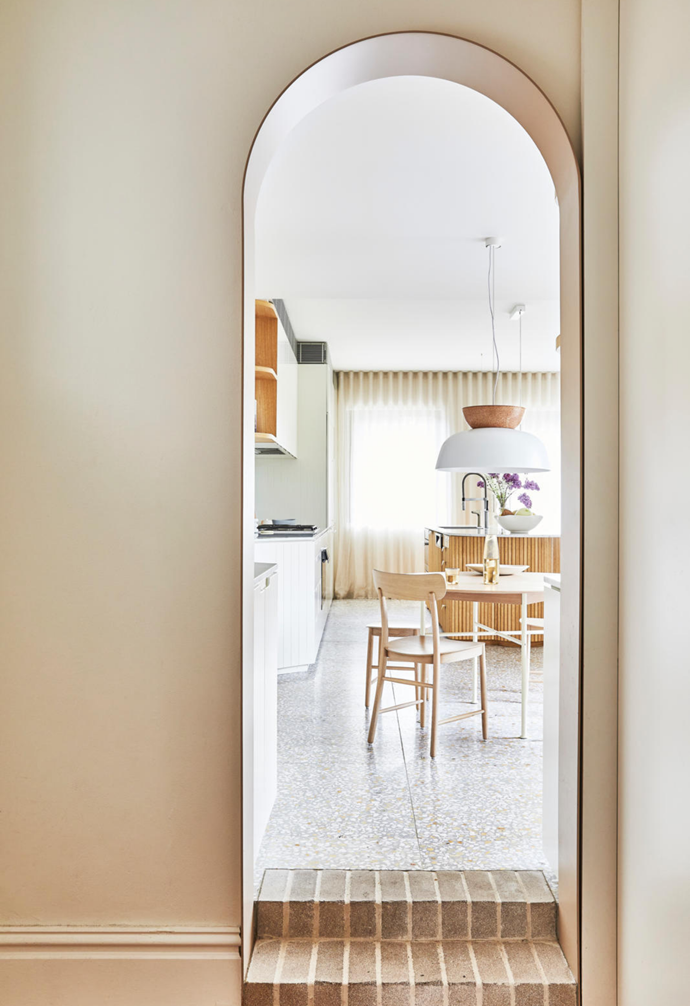 """A change of materials and an eye-catching arch mark the end of the old section of the home and the start of the new. """"We're so proud of the way we were able to bring light into the existing dark spaces, creating a joyous living space for the family,"""" Julie says."""