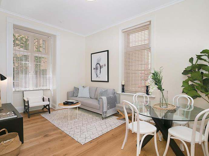 The apartment features a light-filled, open-plan layout.