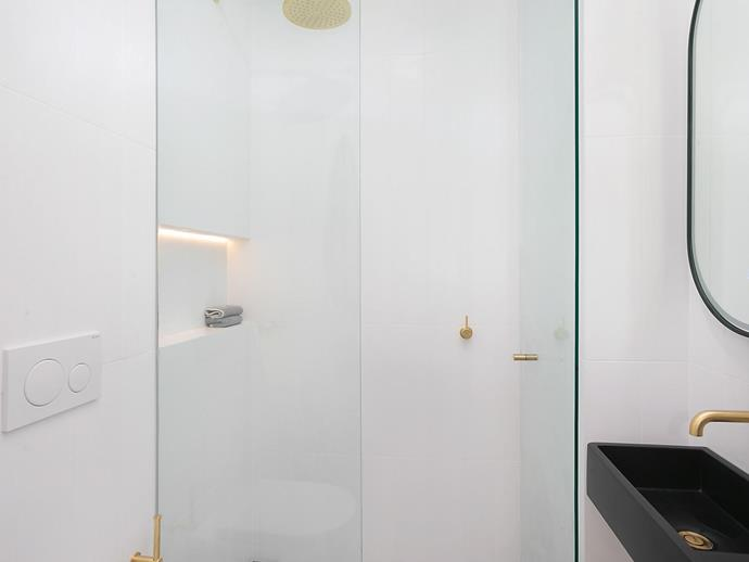 The modern bathroom complete with brass hardware.
