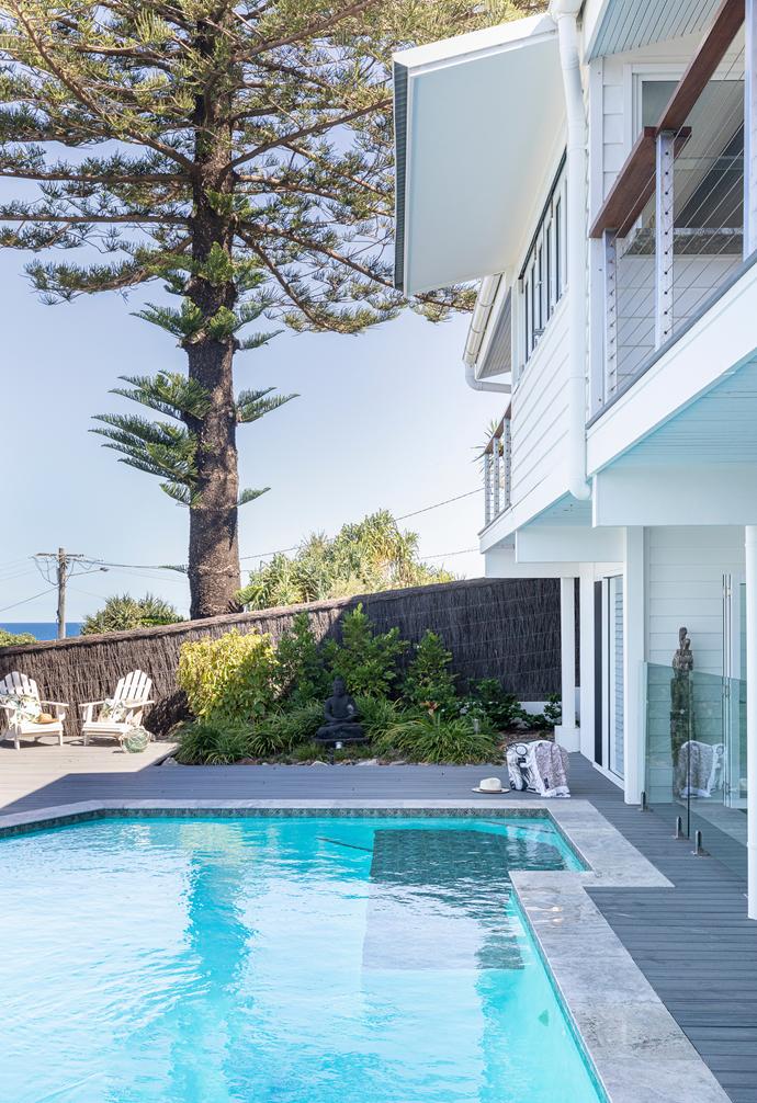 The glistening pool overlooks the ocean.