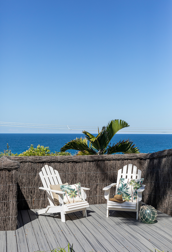 A pair of classic Adirondack chairs invite time-out in the sun.