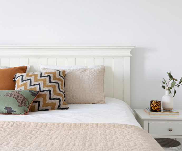 In this luxurious sleep zone, Sheridan bedlinen and a Pillow Talk comforter join with an array of plump and colourful patterned cushions for a decidedly inviting look.