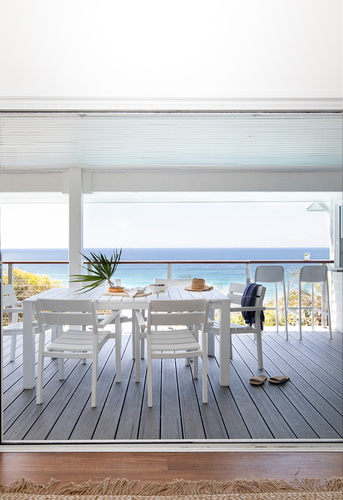 """Capitalising on its heavenly location, the alfresco deck – conveniently located off the kitchen – is forever in use by the family. """"I most love what we call 'The Nickie Bar' after my daughter-in-law Nickie, as she came up with the idea for it. It's the area where the two all-weather bar stools sit,"""" says Jo with a smile. """"The bench is wide enough for a small cheese platter and wine glasses, and it's a lovely spot for early morning coffee and early evening cocktails."""""""