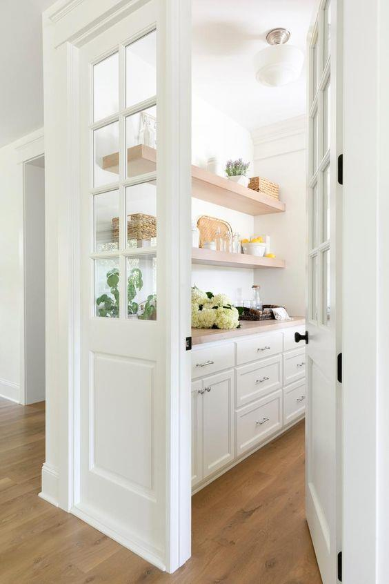 "Simplistic white cupboards and glossy tiles create a minimal, yet refined butler's pantry that connects to the kitchen area through an open entry point in this [classic farmhouse meets chic furnishings home](https://www.pinterest.com.au/pin/AavoZdkEuLet7TuNqxqEhllC9Xz_Y3r_9otuzEJFffhjwyImkzizVrU/|target=""_blank""