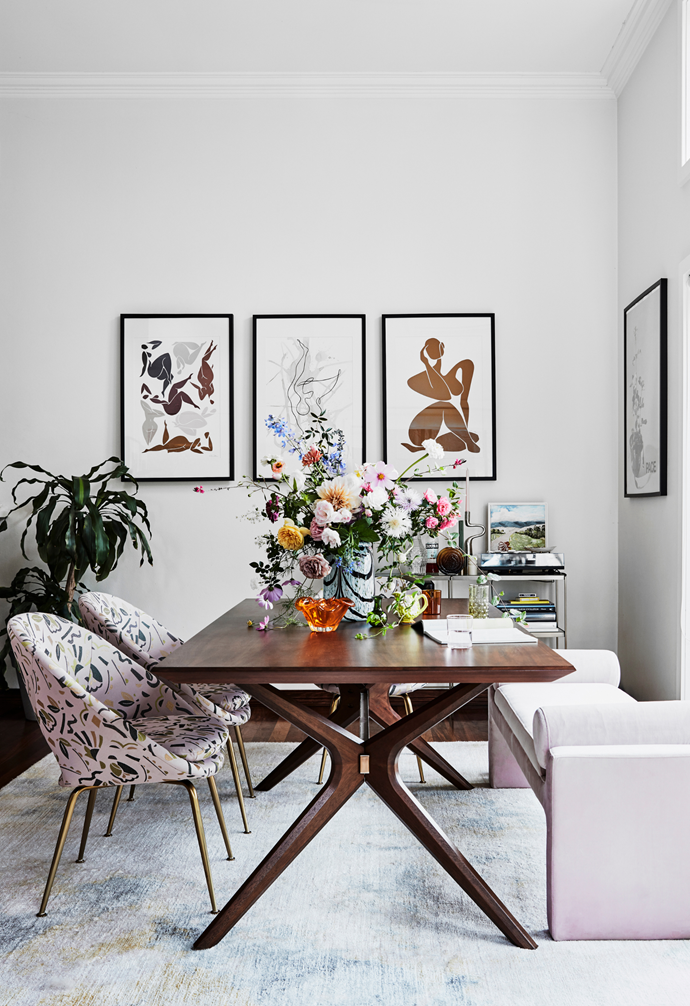 The West Elm dining table is perked-up with patterned West Elm chairs, a shapely Coco Republic 'Bleecker' bench and a Splash vase from Hay. On the wall are three framed artworks by Klara Laba and on the console is a Catherine Hickson artwork from Art2Muse.