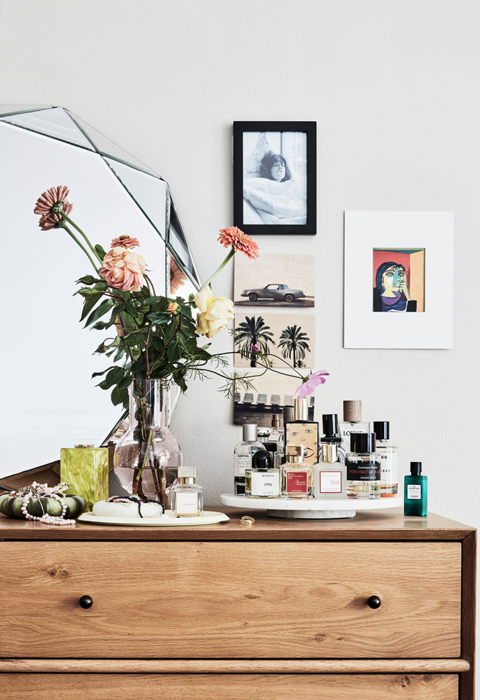 Arranged on a stand alongside a Respiro bag, Maison Balzac vase and Hay tray, Ana's fragrances create a chic vignette. Above is a Picasso print and postcards from Merci Paris.