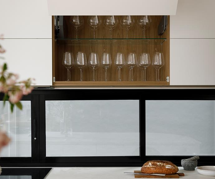 Achieve a contemporary, seamless style in the kitchen with bi-fold lift-up cupboards, as seen in Luke and Jasmin's kitchen on last year's series.
