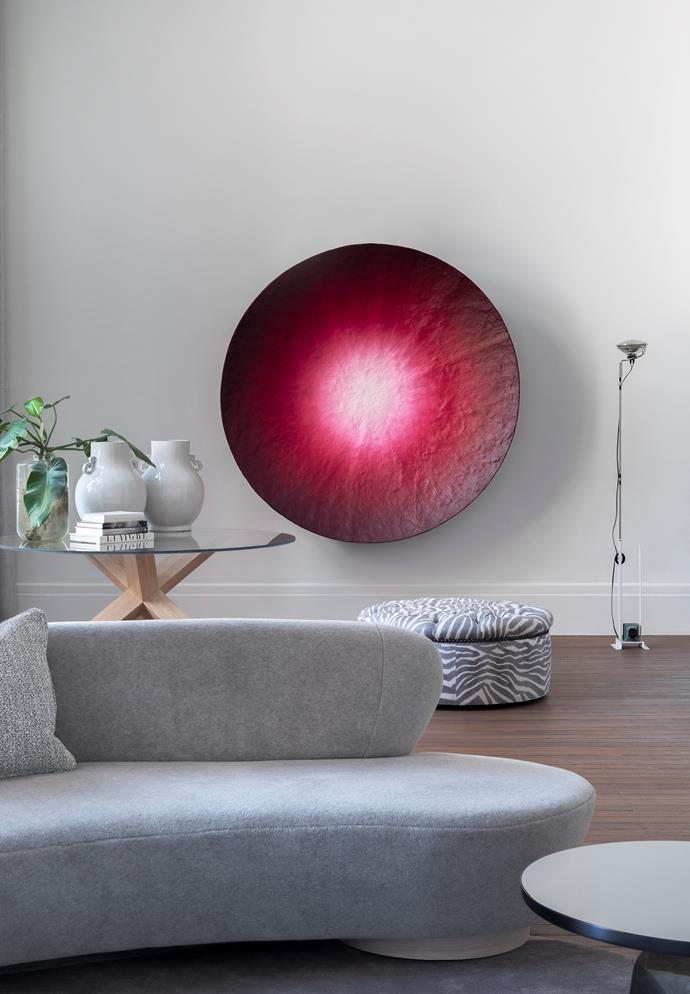 Artwork by Ryan Hoffmann from Liverpool Street Gallery. Cassina 'La Rotonda' table by Mario Bellini and a custom ottoman by Iain Halliday. Flos 'Toio' floor lamp by Achille and Pier Giacomo Castiglioni from Euroluce.