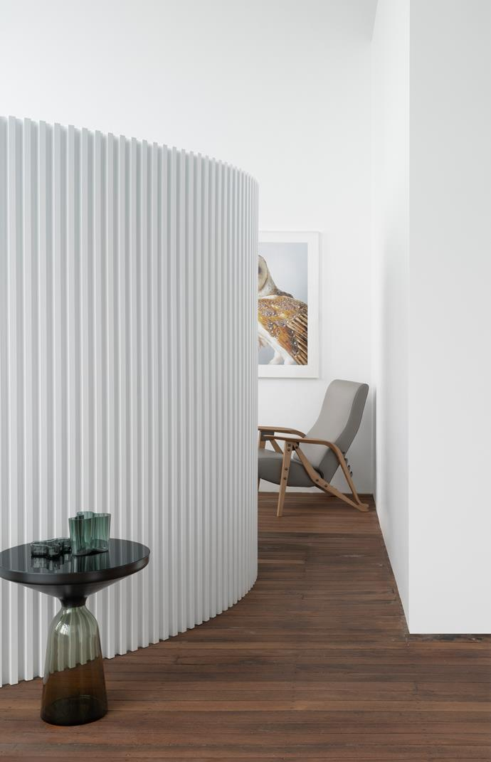 Ivy Barn Owl artwork by Leila Jeffreys from Olsen Gallery can be seen behind the two-metre-high screen wall that was installed to create a guest sleeping area. ClassiCon 'Bell' table from Anibou and Zanotta 'Gilda' armchair by Carlo Mollino from Cult.
