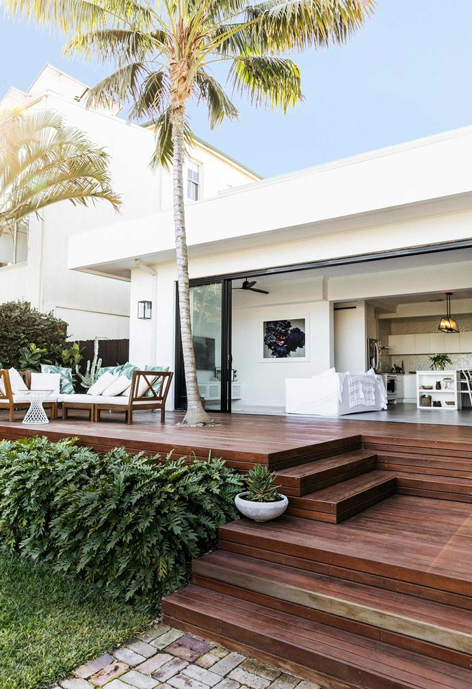 """**Backyard** The outdoor area was painstakingly redesigned by the Kings, with a helping hand from Kirsten's father. Built around an original palm tree is decking by [Landart](https://www.landart.com.au/