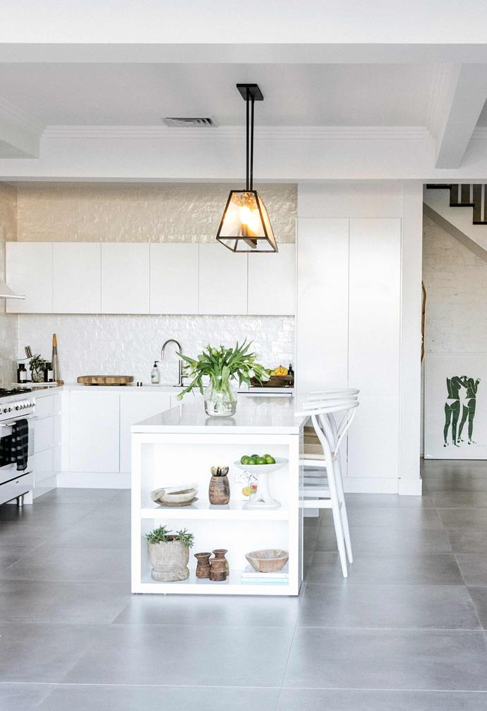 """**Kitchen** All-white cabinets by CLK Joinery feature with pearl-like Mallorca subway tiles, also from [Teranova](https://teranova.com.au/