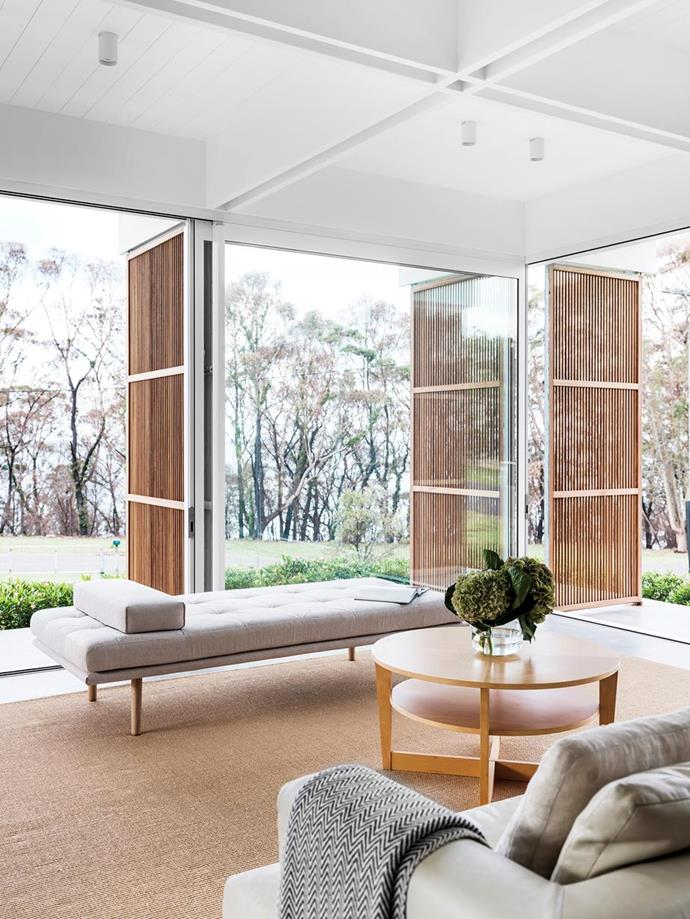 """Mid-Century style meets modern, eco-friendly design at this [outward-looking home on the NSW South Coast](https://www.homestolove.com.au/mid-century-modern-eco-friendly-home-22190