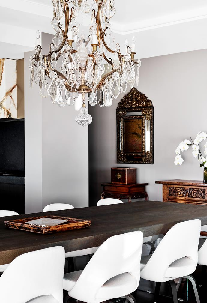 The 19th-century bronze French chandelier was purchased in Paris for the couple's previous home and David modified it to fit over the dining table in the new home. The antique cushion mirror was also purchased in Paris. Carlos II-style oak console from Graham Geddes Antiques. Lago 'Air' dining table from Misura. Knoll Saarinen 'Executive' chairs upholstered in white linen. Walls painted in smoky Dulux 'Caps'.