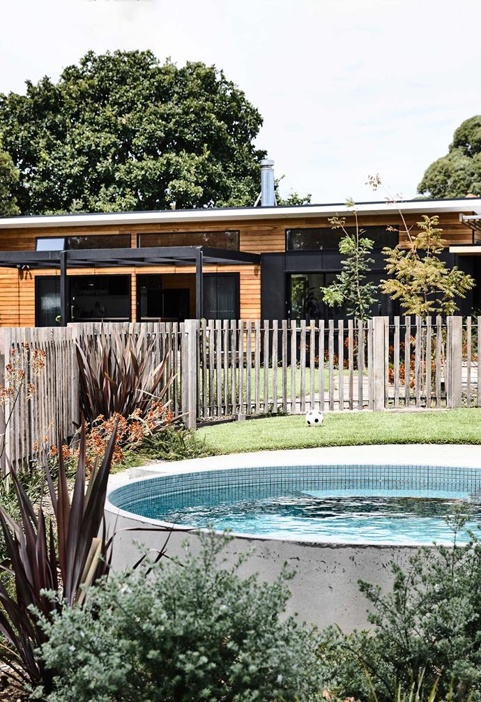 As they're often clad in wood, prefab homes look great in natural or even native landscapes, such as this pool area looking back towards the property