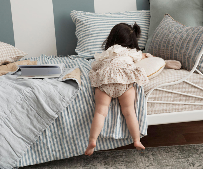 Minnen bed frame, $149, Ikea. Linen pillowcase and fitted sheet in Beige Gingham,as before. Summer & Storm mini duvet in Powder Blue and Sand, $115, Nuage. Bamboo Lyocell flat sheet in Starlight Blue Stripes (part of sheet set), $220 for single, Ettitude. Linen pillowcase in Marine Stripe (part of sheet set), $395 for double, I Love Linen. Smartie round cushion in Natural, $74, Kido Store. Luca Sky cushion, $160, Jardan. Lafayette striped cushion in Whisky, $165, The Society Inc.