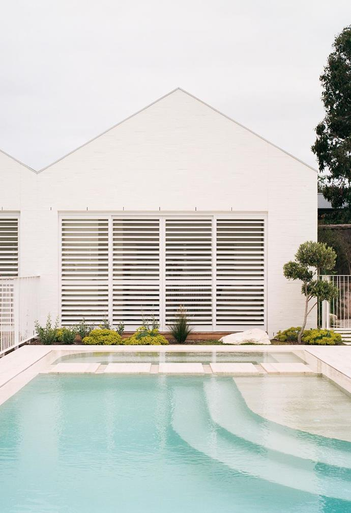 "The brick exterior of this [serene Sorrento home](https://www.homestolove.com.au/coastal-modern-minimal-home-sorrento-22203|target=""_blank"") was rendered white to give it a Palm Springs and minimal aesthetic."