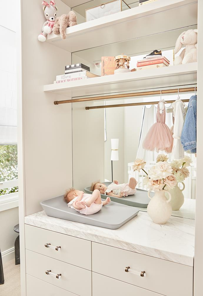 Neutral cabinetry and a marble topped bench offer plenty of storage.
