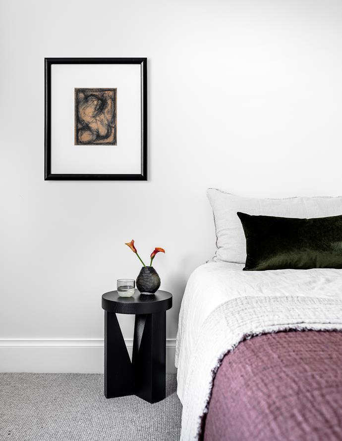 Mattiazzi 'Cugino' side table from HG Furniture Solutions. Vase and velvet cushion, Maison et Jardin. Assorted bedlinen from Hale Mercantile Co and In Bed. Vintage artwork.