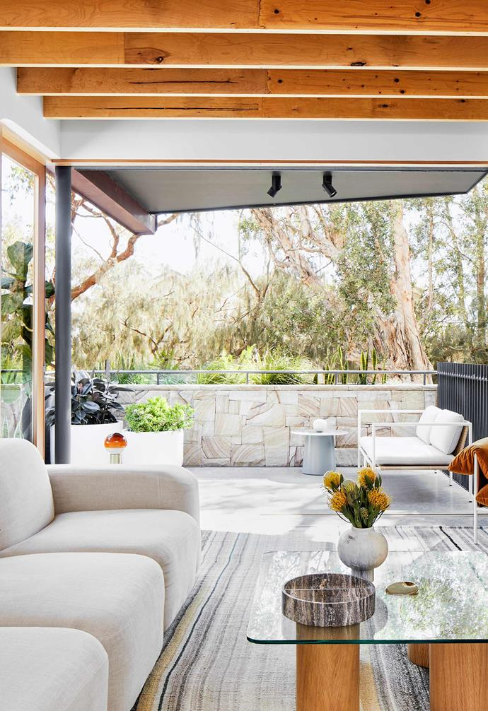"**Living area** The living area connects seamlessly to the outdoor entertaining area. Rug, [Cadrys](https://www.cadrys.com.au/|target=""_blank""