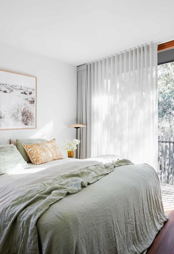 "**Main bedroom** Sheer curtains from Mansours diffuse the light. Sheets, [Bed Threads](https://bedthreads.com.au/|target=""_blank""