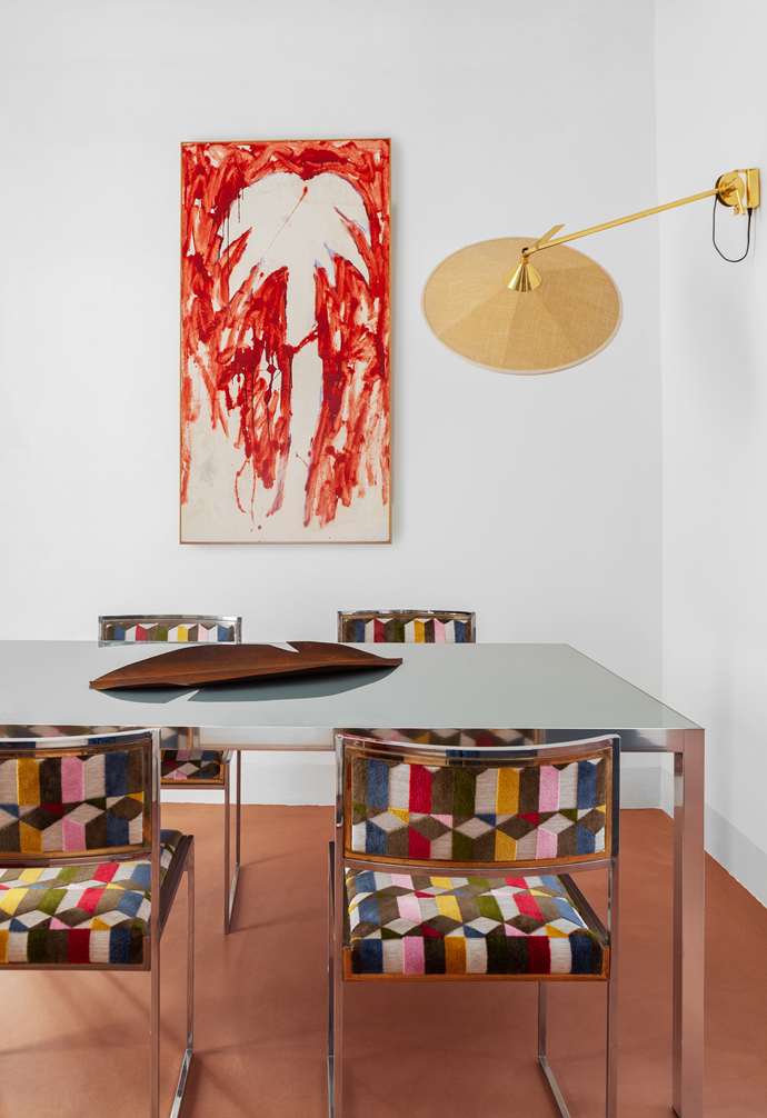 The dining room is a feast of Italian design. The table is by MDF Italia, the chairs are by Willy Rizzo, the Portofino lamp is by Servomuto and on the table is a decorative banana leaf by a local artisan. On the wall is an artwork by Mario Schifano from the '70s. Letizia says it's part of her family's art collection.
