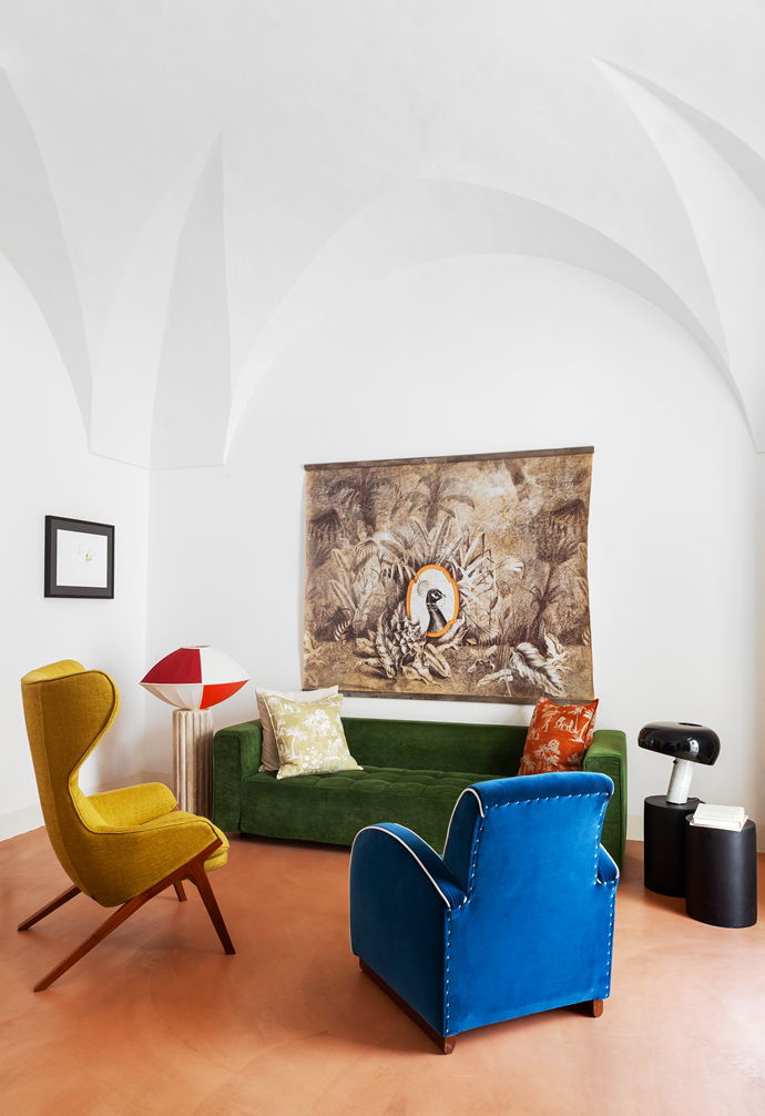 "The velvet Cassina sofa in the [living room](https://www.homestolove.com.au/living-room-essentials-3466|target=""_blank"") is the perfect spot to relax or gather with friends. The yellow armchair is a Patrick Norguet 'P22' design from Cassina, the blue aviator armchair is from a local vintage shop. Above the sofa is an Indian paper artwork, sourced from a shop in Rome's design district. The small framed artwork on the wall is by Vettor Pisani."