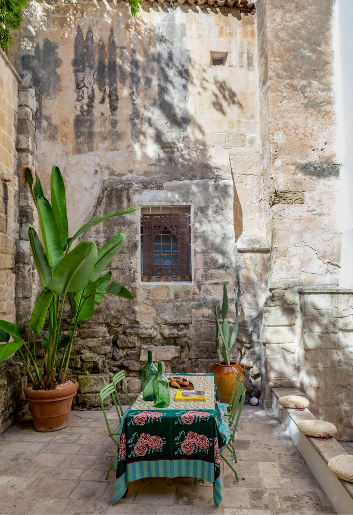 Letizia says the courtyard is an extension of the interior. Here, she likes to relax and listen to music, and when guests are over she styles this space in a Moroccan theme. The table setting is from Ethimo, an Italian outdoor furniture company and the tablecloth is by Lisa Corti, from her shop in Rome.