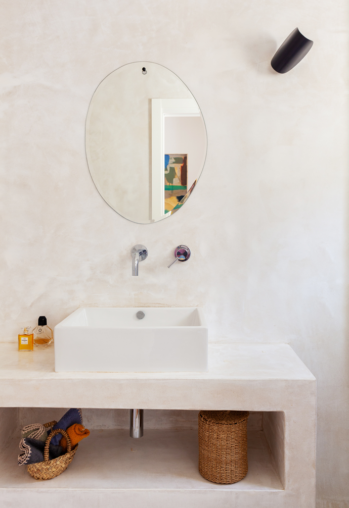 The couple went for a Moroccan- inspired look with a lime plaster effect in this bathroom. Letizia particularly loves the unframed mirror's organic, irregular shape.