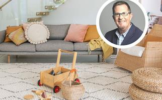 Image of a lounge room with kids toys on the rug and a portrait of Peter Walsh inset