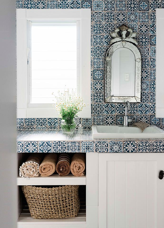 """The laundry was Vicki's first foray into decorating with patterns. """"I never get sick of looking at those tiles,"""" she says."""