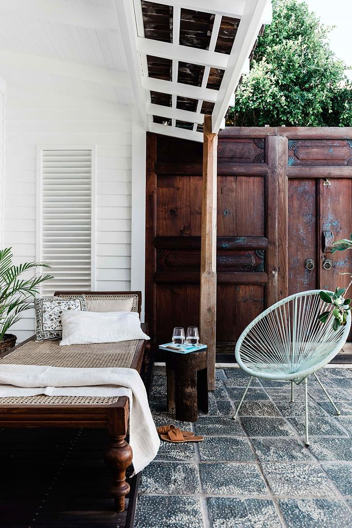 """""""I love the little shell shape on the wall,"""" says Vicki of the wooden wall in their backyard."""