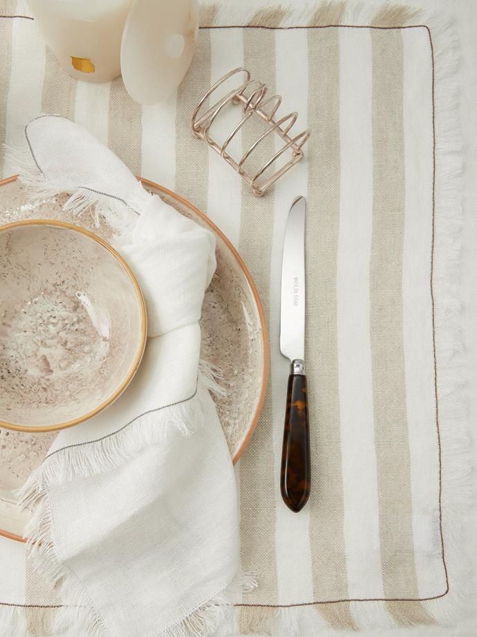 """This elegant set of linen placements are the accessory that will turn an Uber eats Friday night at home into a 5-star restaurant experience. Plus, their neutral stripes make them a timeless favourite with tassles to bring a little fun.  <br><br> Brunello Cucinelli Set of two chain-trim striped linen placemats, $380, [MatchesFashion](https://www.matchesfashion.com/au/products/Brunello-Cucinelli-Set-of-two-chain-trim-striped-linen-placemats-1403439