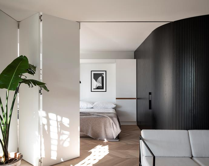 The dining area is easily converted into a second bedroom by folding down the Murphy bed and enclosing the space with internal bifold doors. The artwork above the bed is by Tom Ferguson and the Society Limonta throw is from Ondene.