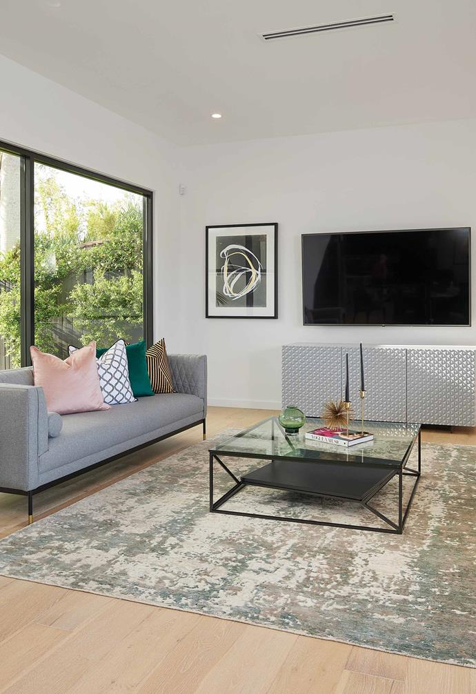 A separate media room is a perfect teenager's retreat and features ample seating for when guests visit.