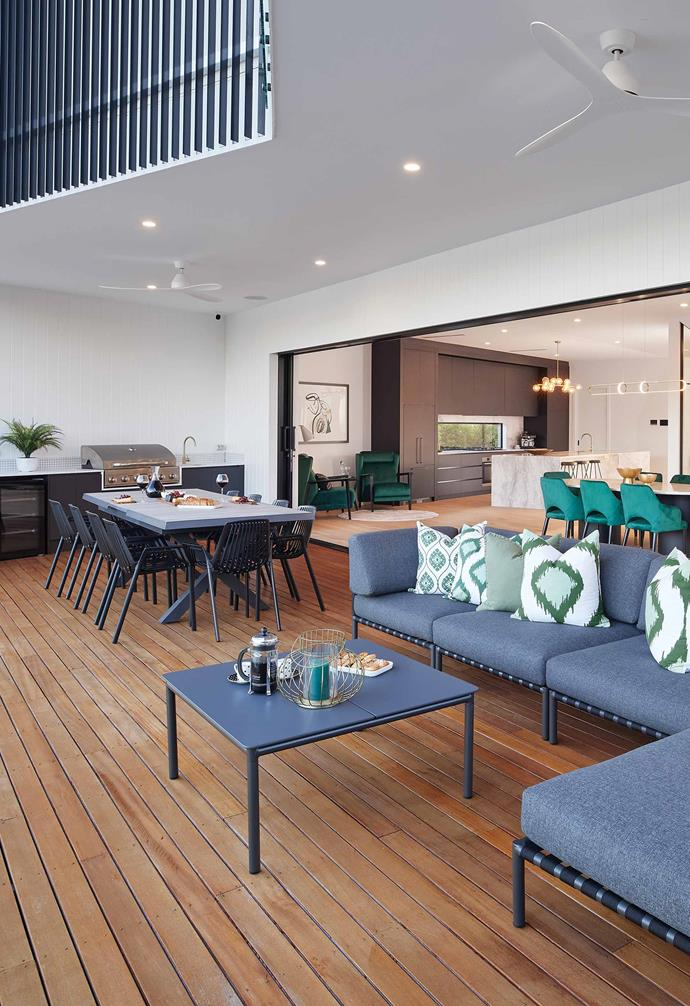 The outdoor entertaining deck is connected seamlessly to the indoors, courtesy of heavy-duty glass sliding doors. An outdoor kitchen complete with sink, barbecue and bar fridge is ready to entertain guests all year round.